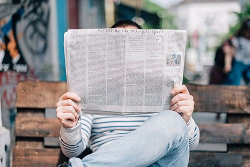photo man sitting on bench reading newspaper free for commercial use images