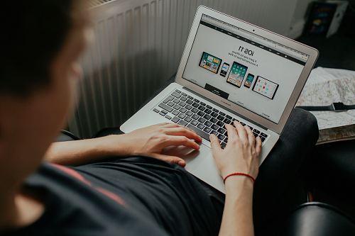 man using MacBook White