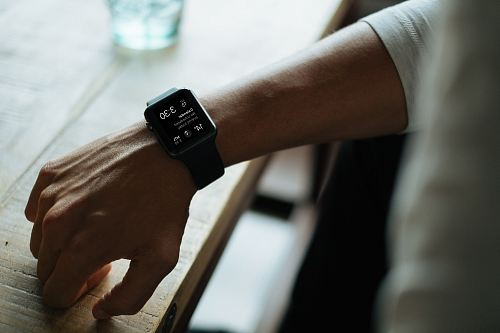 photo man wearing black smartwatch free for commercial use images