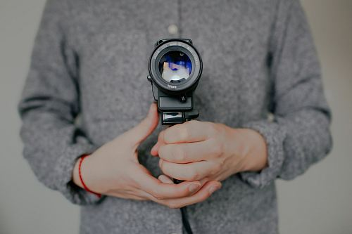 photo person holding DSLR camera free for commercial use images