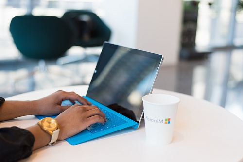photo person using blue Microsoft Surface free for commercial use images