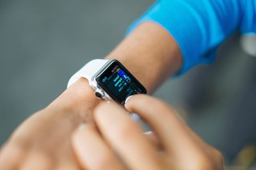 free for commercial use person wearing silver Apple Watch with white Sport Band images