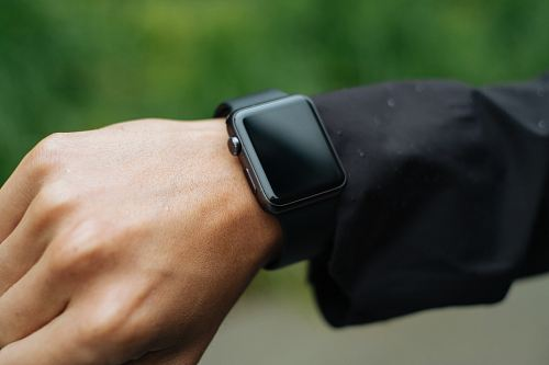photo person wearing space gray Apple Watch turned off free for commercial use images