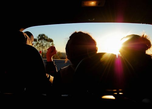 photo silhouette of three person inside car free for commercial use images