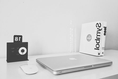 silver MacBook and black JBL