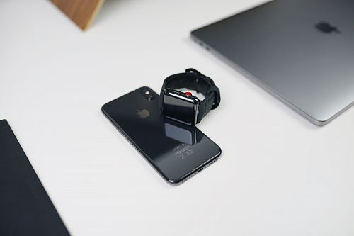 photo space gray aluminum case Apple Watch with black Sport Band on space gray iPhone X beside silver MacBook free for commercial use images