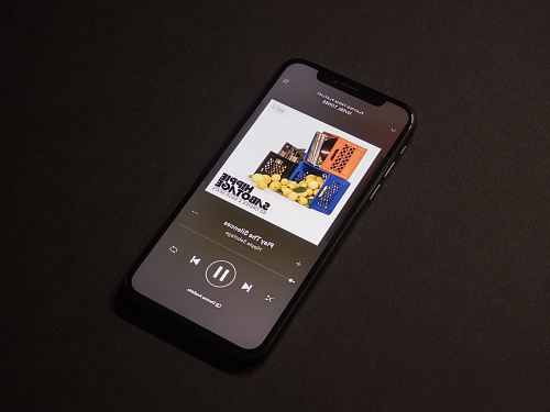photo space gray iPhone X showing Spotify application free for commercial use images