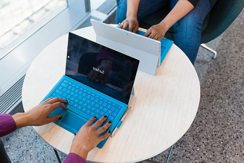 photo two person using Microsoft Surface free for commercial use images