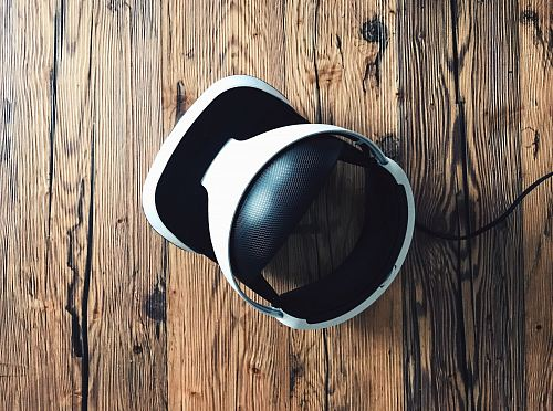 white and black Bluetooth headphones