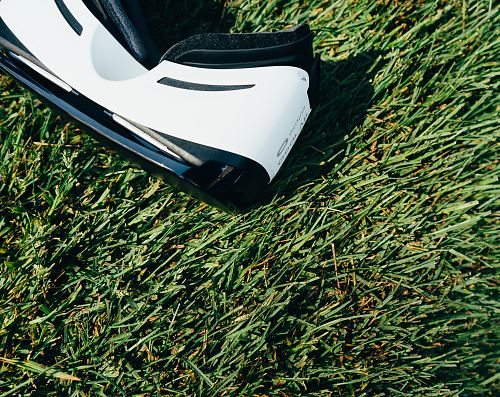 photo white and black VR Box headset on green grass field free for commercial use images