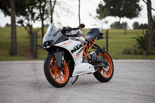 photo white and orange KTM sports bike selective focus photography free for commercial use images