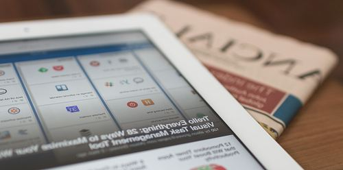 photo white tablet computer on top of newspaper free for commercial use images