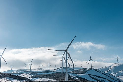 photo wind turbines on snowy mountain under clear blue sky during daytime free for commercial use images
