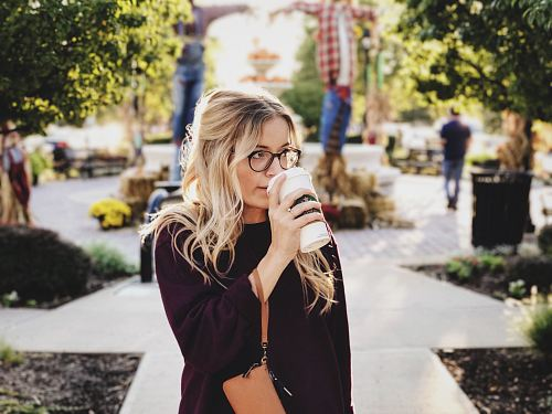 photo woman drinking on white cup free for commercial use images