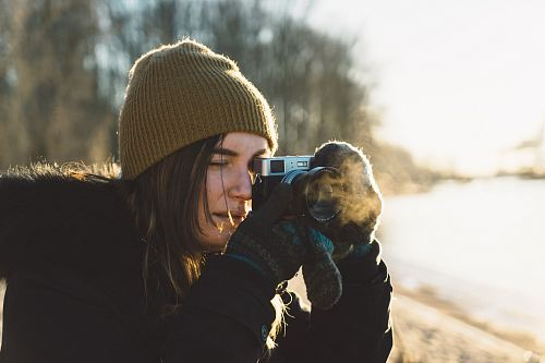 photo woman holding SLR camera free for commercial use images
