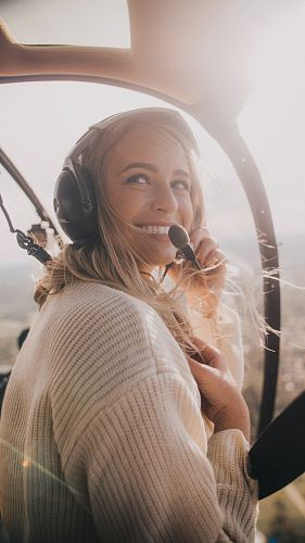woman in white knit sweater inside aircraft