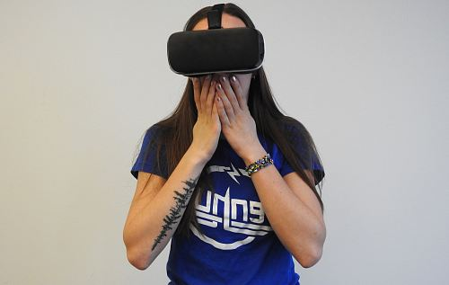 woman using black VR headset