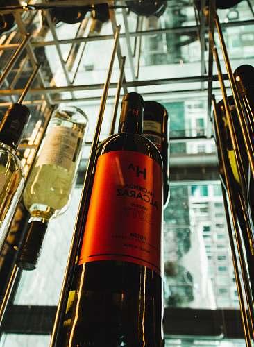 alcohol orange labeled wine bottle drink