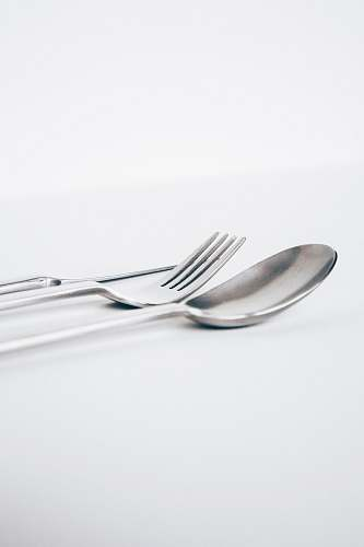 grey spoon and fork fork