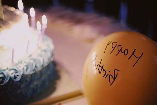 food yellow balloon near cake birthday cake