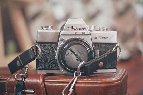 electronics black and gray Minolta camera strap