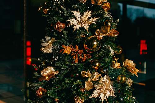 gold Christmas tree with decors holiday