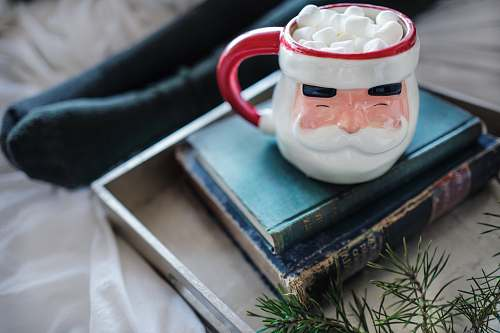 cup white and red ceramic mug on books christmas wallpapers