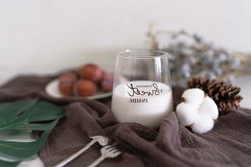 brown white liquid in glass cup milk