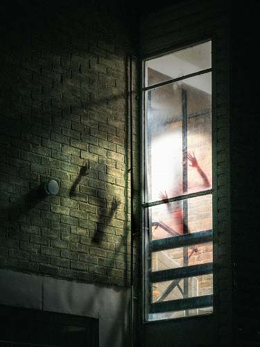 window gray glass frame brick