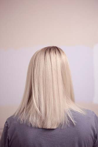 blonde woman wearing gray top woman