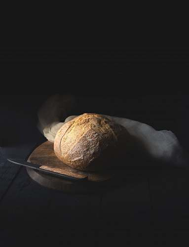 photo table baked bread beside knife on wooden board bread free for commercial use images