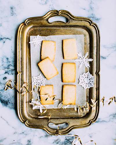 christmas brass tray on white marble surface holiday