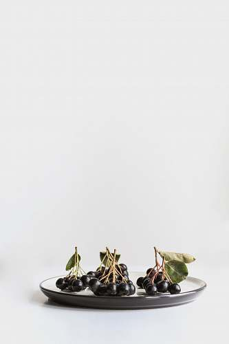 fruit bunch of grapes on ceramic plate dish