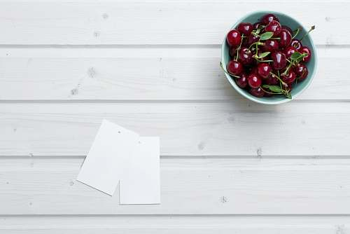 photo fruit cherries in bowl beside paper cherry free for commercial use images