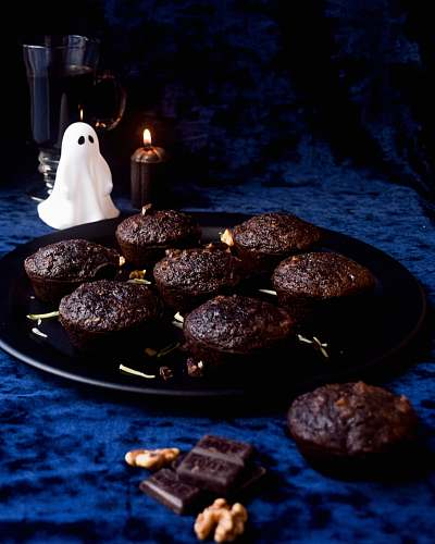 dessert cookies on black plate candle