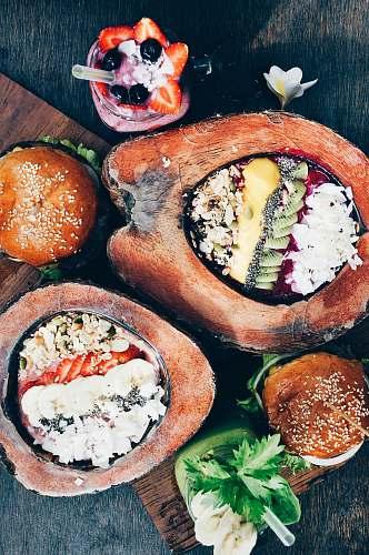 bali flat-lay of hamburger, fruit salad, and strawberry shake indonesia