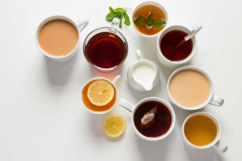 tea flat-lay photography of variety of beverage filled glasses drink