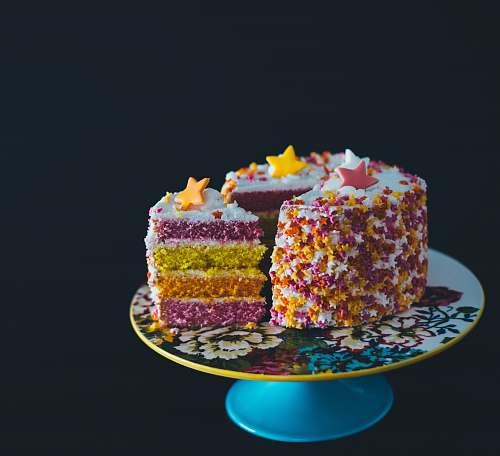 cake sliced cake top with star raisins on cake stand birthday cake