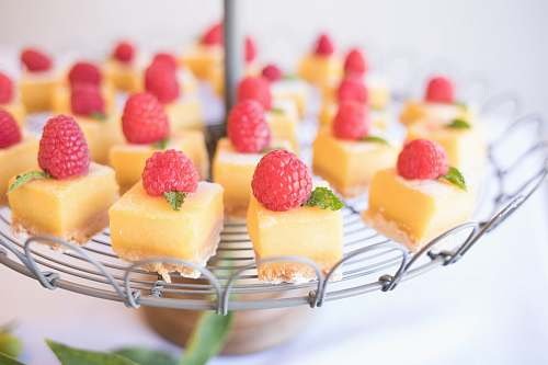 fruit square strawberry cheesecake on round gray metal stand dessert