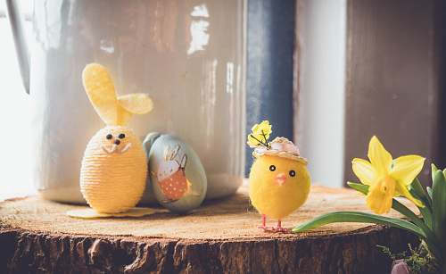egg yellow bird plush toy on brown wood toy