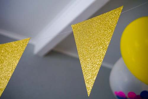 triangle yellow glitter buntings hanging inside room confectionery