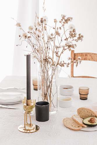 table bread and flower placed on table tabletop
