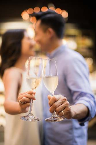 photo human selective focus photography of couple holding cocktail glasses person free for commercial use images