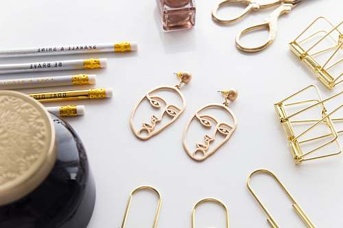 weaponry gold-colored face-cutout earrings weapon