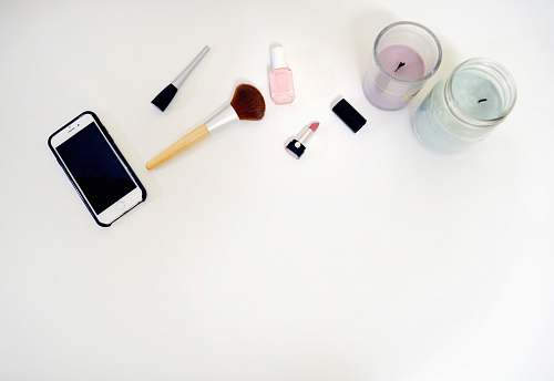 makeup styled stock silver iPhone 6 beside makeup brush flat lay