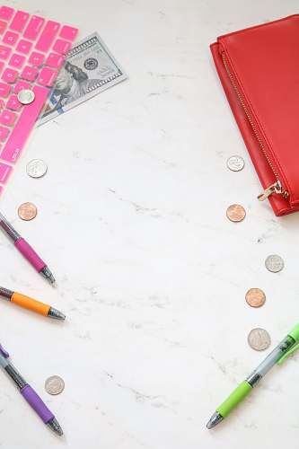 money photo assorted-color pens on top of table money styled stock
