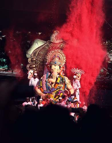 person Ganesha statue surrounded by people human