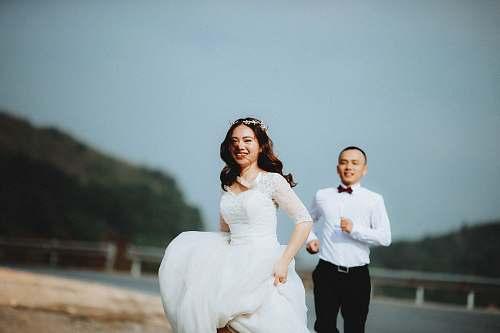 person man chasing woman during daytime human