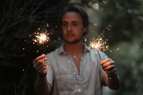 person man holding sparklers human