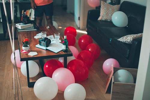 human assorterd-color balloons party